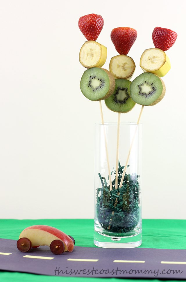 Make these traffic light fruit kebabs with strawberry, banana, and kiwi. Great for a centrepiece at your road trip birthday party!