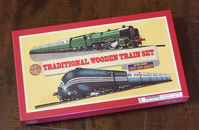 The Traditional Wooden Train Set comes with two engines, four train cars, a station house, and over five feet of wooden track.