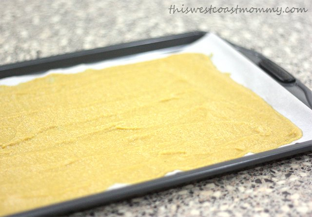 Spread the pumpkin puree in a thin layer over parchment paper or a silicon baking mat.