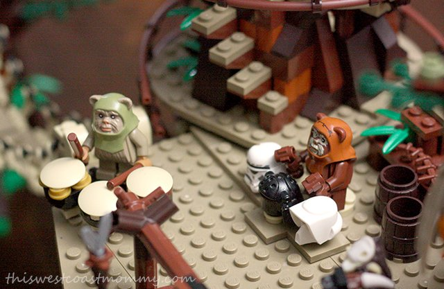 The Ewoks celebrate their victory over the Imperial forces with a feast and drumming on trooper helmets.