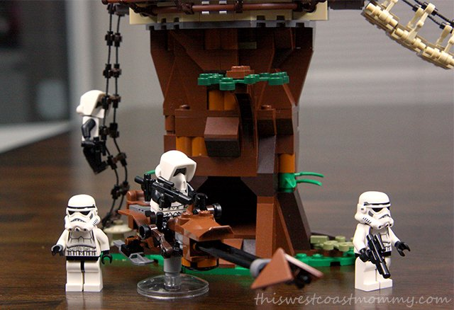 Scout troopers and storm troopers patrol the jungle looking for the rebels.