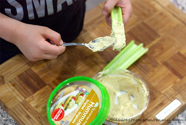 Update your classic ants on a log snack with Summer Fresh hummus. Easy, healthy, delicious, and safe for peanut-free schools!